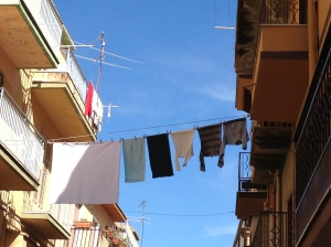 The village's main street is the widest, so it's the best place to hang laundry.